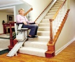 Young Lady on straight stairlift in Swansea